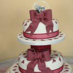 Burgundy bows & hearts wedding cake, Lytham St Annes, Lancashire