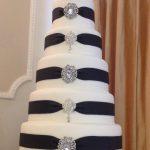 Black ribbon & diamante brooch wedding cake