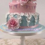 Vintage style wedding cake with roses & bunting