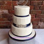 White & navy wedding cake with diamante