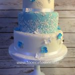 Ice blue, lace & butterfly wedding cake