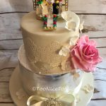 Two tier wedding cake with Lego topper Lancashire