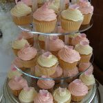 Cup cakes with cream cheese frosting topped with sugar rose petal or butterfly Â