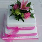 pink fresh flowers wedding cake Lytham St Annes, Lancashire